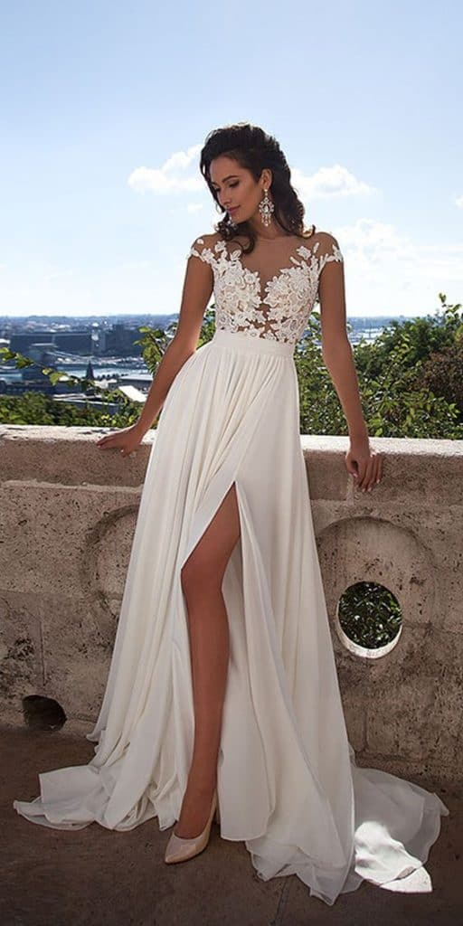 3c35d87121 8 of the Prettiest Caribbean Beach Wedding Dresses - Petite Anse Hotel
