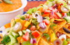 Nachos, vegetables and cheese sauce